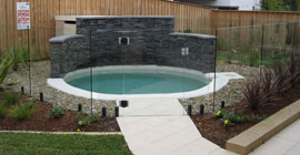 Beautiful round feature pool and glass
