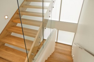 Dramatic wooden stairs framed by glass