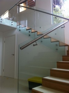 Glass balustrade with toprail